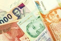 Valute di carta asiatiche Fotografie Stock Libere da Diritti