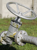 Valve for closing and opening of the underground piping Royalty Free Stock Photography