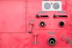 Valve control on fire engine truck look like human face Royalty Free Stock Photos