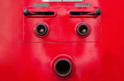 Valve control of fire truck look like human face Stock Photography