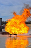 Valve on Fire with high flames. Gas valve on fire burning high Royalty Free Stock Photos