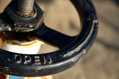 Valve Handle. A black valve handle with the word open Stock Photo