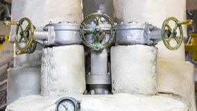 Multiple Brass Steam Valves. Valve handles control and direct main steam into shipboard propulsion system Stock Photos