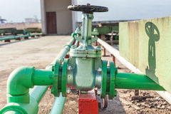 Valve mounted on rooftop industry building Stock Image