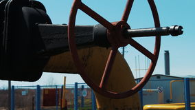 Valve on oil and gas pipeline. A processing and storage station for natural gas. oil industry. Close-up of the shut-off stock video footage