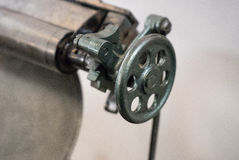 Valve  of the old machine in printing house Royalty Free Stock Photography