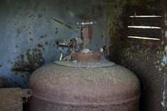 Valve on old rusty gas cylinder. Valve on an old rusty gas cylinder with cobwebs and dust Royalty Free Stock Photo
