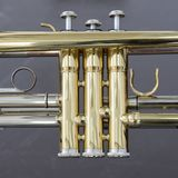 Part of loud brass orchestra instrument trumpet. Valve part of loud brass orchestra instrument trumpet Stock Photos