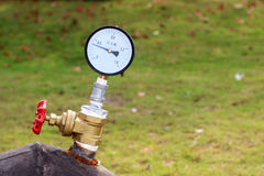 The Valve and the pressure gauge Stock Photos