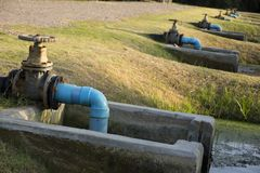Valve for shutting off in waste-water treatment pond. Big valve gate for shutting off in waste-water treatment pond stock image