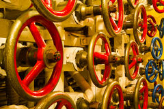 Valve wheels inside old submarine Royalty Free Stock Photo
