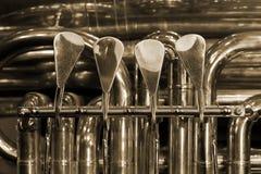 Valves bass tubas. Worn valves bass tubas closeup Royalty Free Stock Image