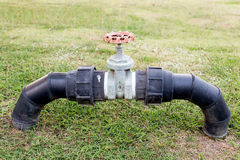 Valves for control used water in the park Royalty Free Stock Photos