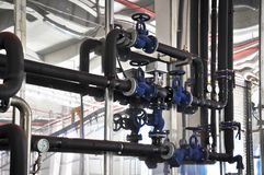 Valves in a factory where the pressure system is controlled royalty free stock photos