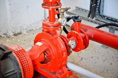 Valves in a factory where the pressure system is controlled. Red valves controlling the pressure system stock photo
