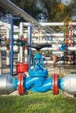 Valves at gas plant Stock Photos