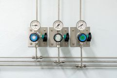 Valves of nitrogen, Helium, Oxygen  Air Zero pipes and Gas Pressure Meter with Regulator for monitoring measure pressure. Production process in Chemistry royalty free stock images