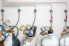 Valves of nitrogen, Helium, Oxygen  Air Zero tank and Gas Pressure Meter with Regulator for monitoring measure pressure. Production process in Chemistry stock images