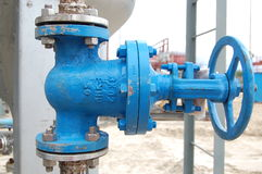 Valves at oil-factory. Royalty Free Stock Photography