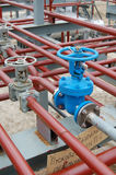 Valves at oil-factory. Industrial zone Royalty Free Stock Images