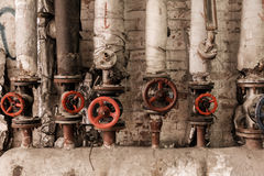 Valves of old steam at factory Royalty Free Stock Images