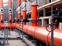 Valves and orange steel pipes Stock Photo
