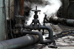Valves and pipes in dirty environment. Stock Image