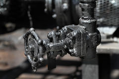 Valves and pipes in dirty environment. Royalty Free Stock Photos