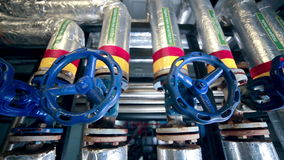 Valves, pipes, gauges at a Gas and oil production plant. Slider shot. stock video footage