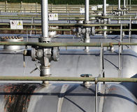 valves and piping above the pressure vessel of a plant Stock Images