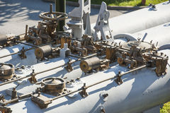 Valves and piping on large naval gun Stock Photo
