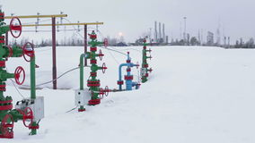 Valves on a production wellhead in winter, close-up. stock footage