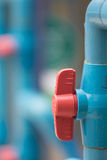 Valves on PVC pipes. PVC pipe valves used in the water pipe Stock Image