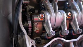 Valves and Valve Mechanisms in Motorcycle Engine. Camshaft motorcycle engine.