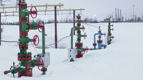 The valves at the wellhead production. In the stock footage