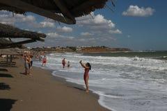 Vama Veche seaside nonconformist resort in summer day. People on beach in Vama Veche in Romania on August 25, 2016 Stock Photo