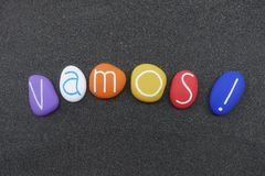 Vamos, let`s go in spanish language composed with colored stones stock photography