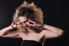 Vamp over dark. Vamp style young woman hands at face over dark Stock Image