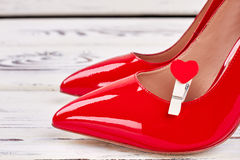 Vamp shoes and heart. Elegant gift for woman Royalty Free Stock Photography
