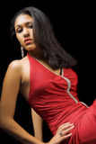 Vamp woman. Beautiful woman in red long dress Stock Photography