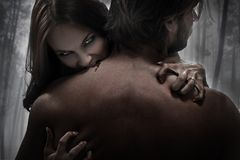 Vamp woman. Beautiful vamp attacking the man Royalty Free Stock Image