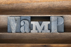 Vamp wooden tray. Vamp word made from vintage letterpress type on wooden tray Stock Photos