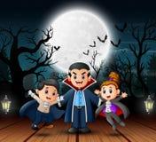 Vampierfamilie in de Halloween-dag in openlucht bij nacht stock illustratie