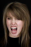 Vampire. With pale face, fangs, and scary eyes Stock Photography