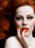 Vampire. Closeup portrait of beautiful redhead vampire woman