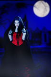Vampire. In the night with moon and castle royalty free stock images