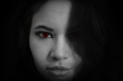 Vampire. A young vampire girl with bright red eyes Royalty Free Stock Photo