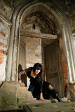 Vampire. Sexy goth girl sitting on a tombstone Royalty Free Stock Photos