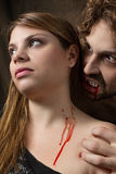 Vampire bites girl Royalty Free Stock Photo