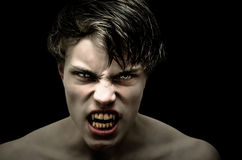 Vampire. Blind on left eye, isolated on black background Stock Images